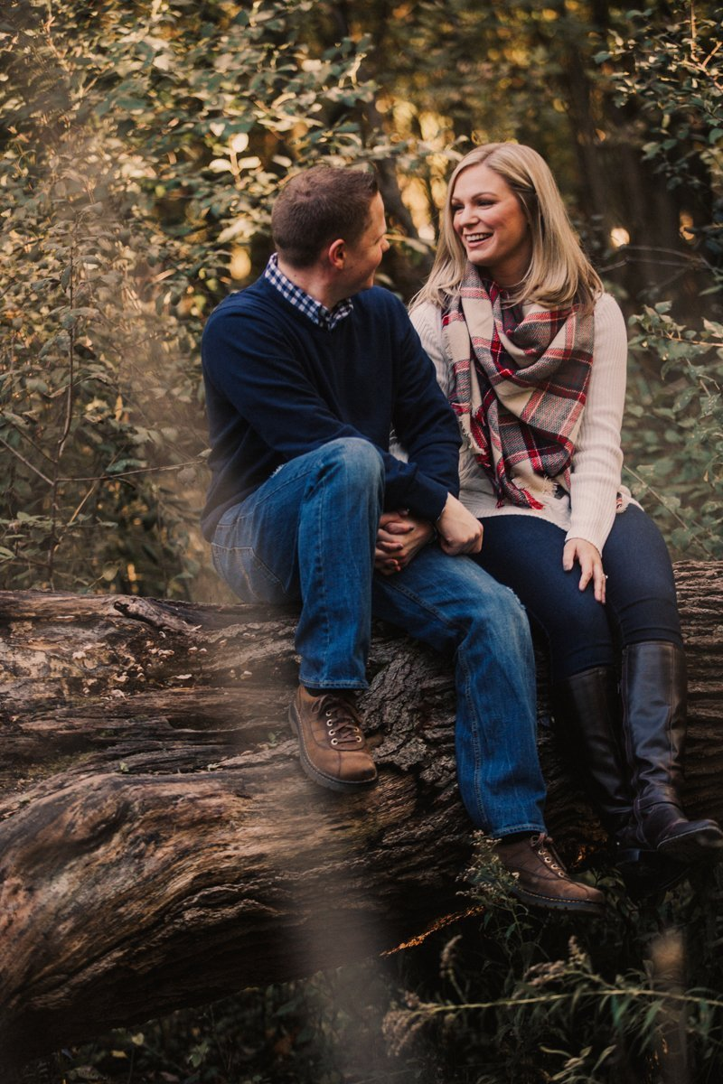 Midwest rustic fall photos couple sitting on tree branch