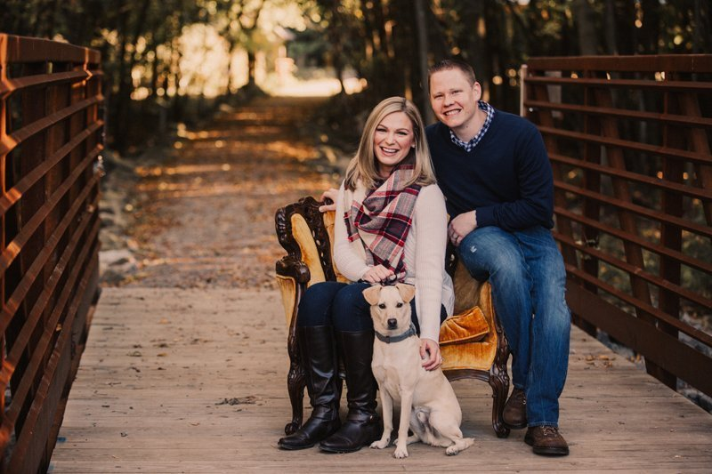 fall family photos vintage chair on rustic bridge