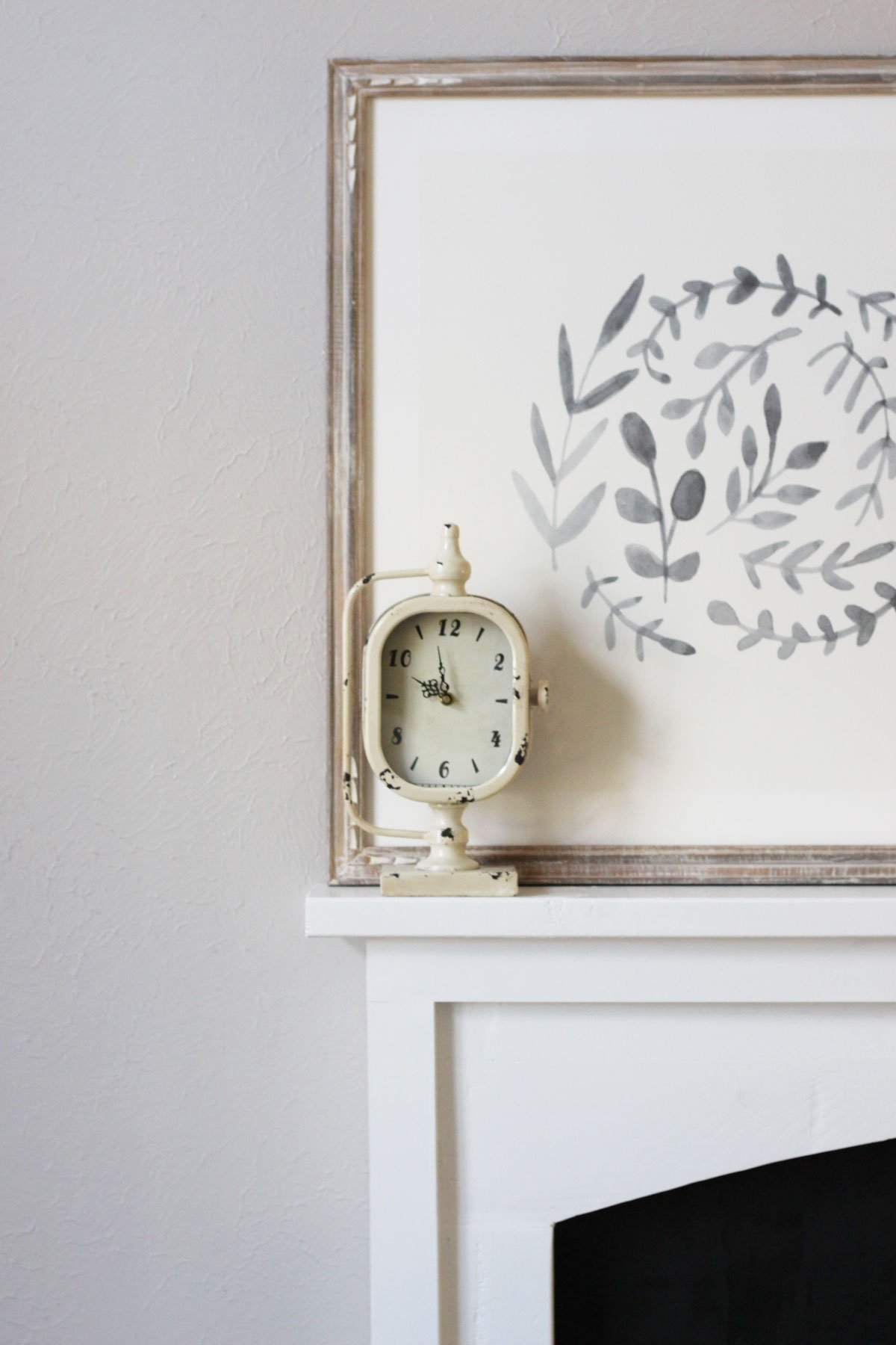 DIY Faux Fireplace Reveal chippy vintage clock