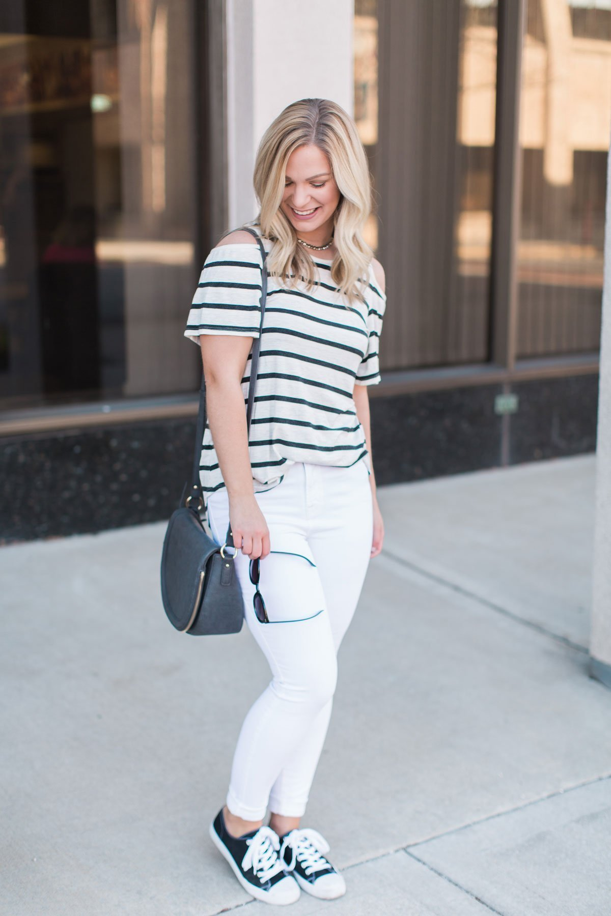 Striped cold shoulder top with white skinnies and black sneakers