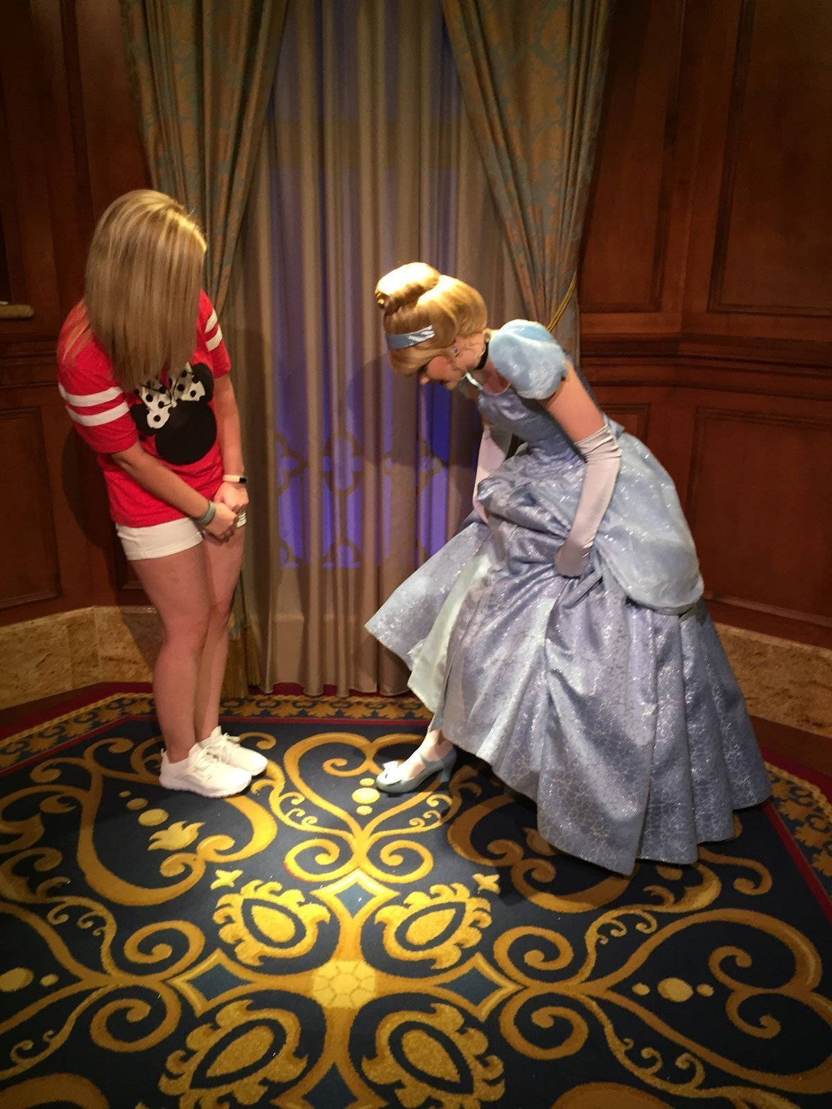 Cinderella showing off her shoes during meet 'n' greet at Magic Kingdom