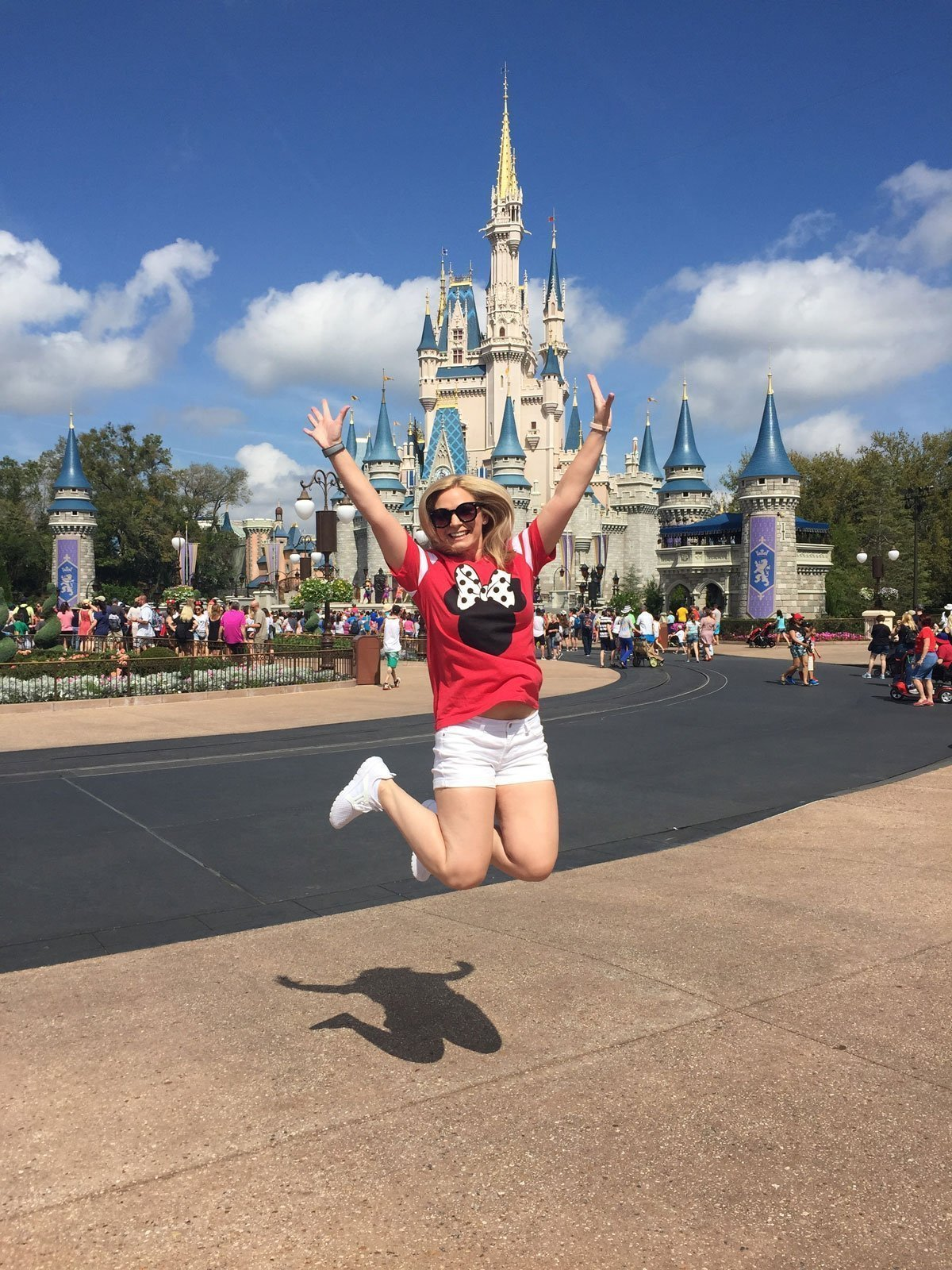 Jumping in front of Cinderella's Castle at Magic Kingdom