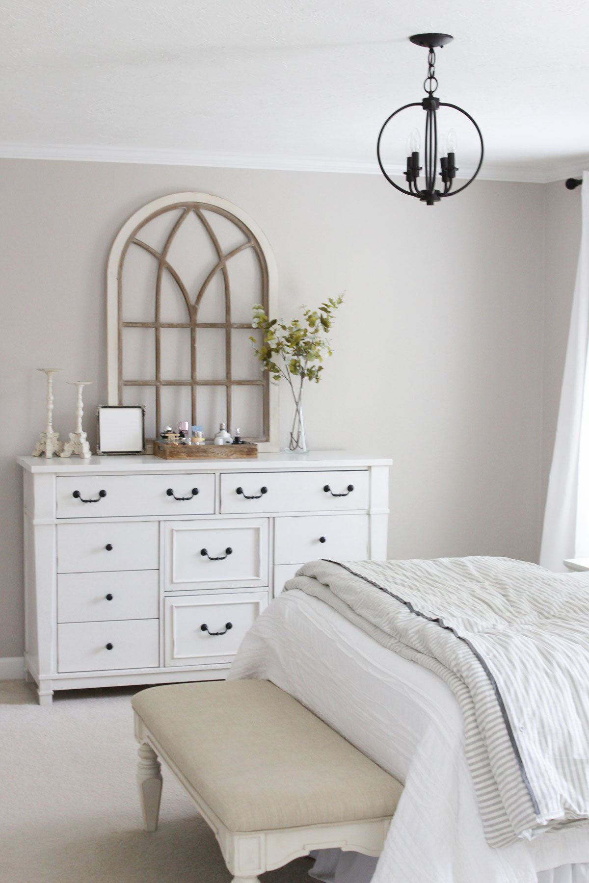 Modern Farmhouse Master Bedroom Reveal white distressed dresser