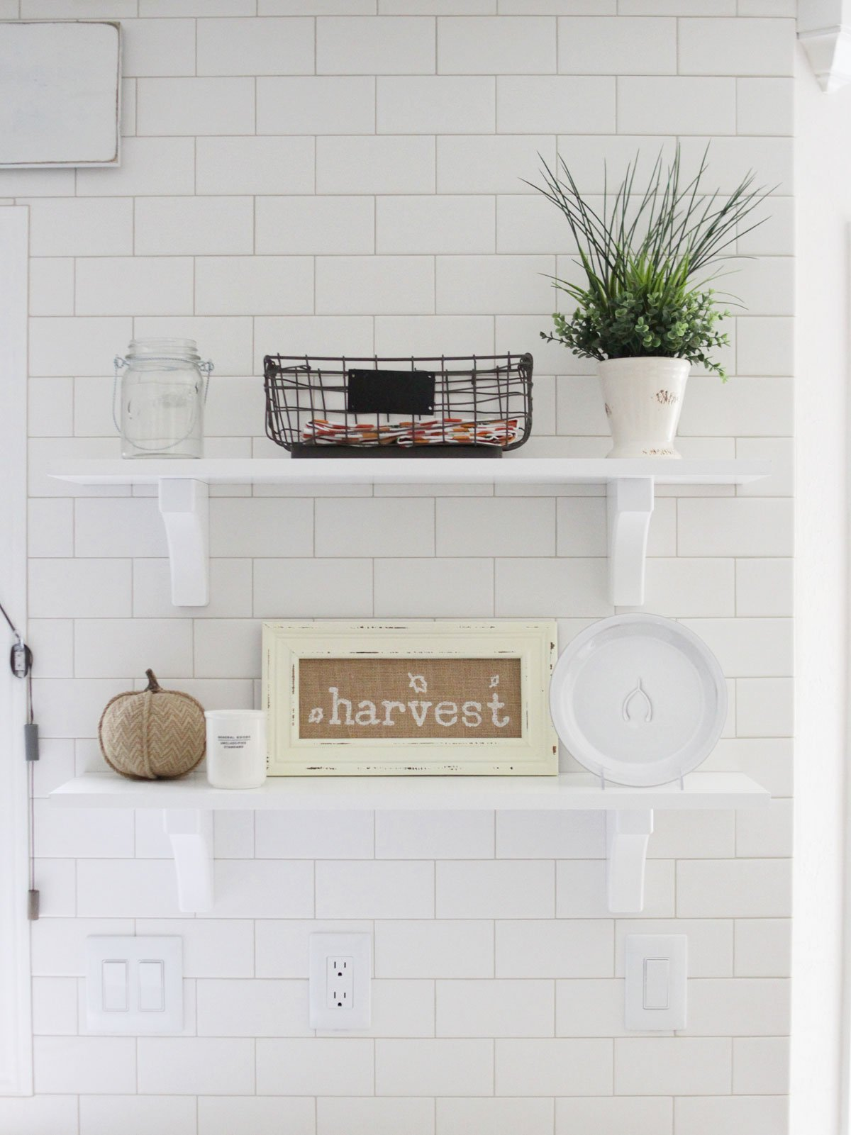 Fall floating shelves in kitchen