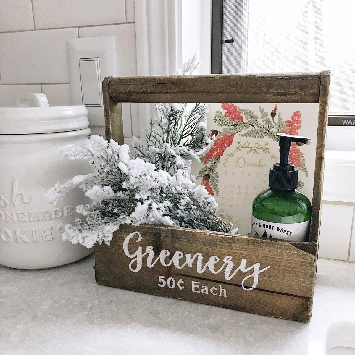 wooden greenery box next to sink