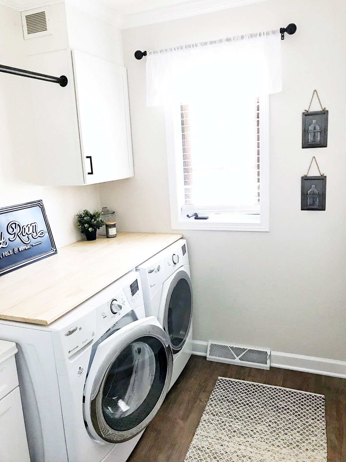 modern farmhouse laundry room white and black decor